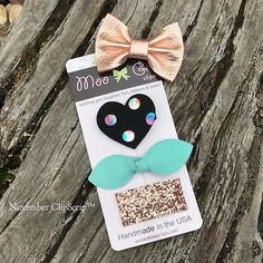 The November ClipScrip is here!! •  Rose gold leather basic bow, black suede with iridescent dots heart, a suede robin's egg blue leather knot bow, and a large glitter snap in rose gold. •  Rose gold + November = 🍂🍁❤️🎀
