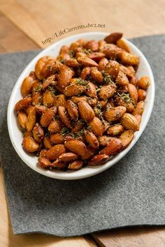Crockpot Herbed Almonds are a great appetizer that are super easy to make becasue you getto use the slow cooker! by Life Currents