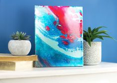 Give your art an abstract feel using the paint pouring method with pouring medium from DecoArt!