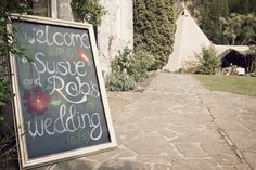 Chalkboard Sign - Image by Weddings Vintage - A Suzanne Neville Wedding Dress For a Teepee Humanist Wedding At Tros Yr Afon With A Red Rose Bouquet By Weddings Vintage.
