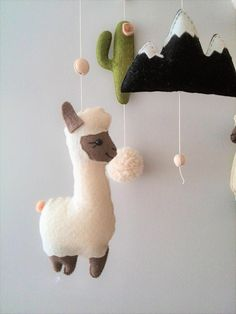 ♥ MADE TO ORDER ♥ This baby mobile in the style of Boho was invented by me for those who love exotic animals and decorates the childrens room in gentle, warm tones pleasant to your eye. Llama or Alpaca alternate through soft pom-poms,cacti and mountain. The mobile is fully handmade,