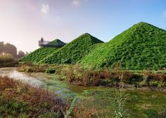 Hexagonal pyramids on the roof of this museum are now covered in a layer of grass, helping the building settle in its marshland setting in the Netherlands