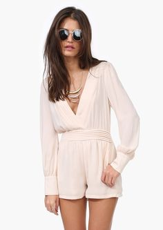 A long sleeved romper! This best seller is a staple for every girl! This has a V neckline with cinched waist line. Has cuffed sleeves w...
