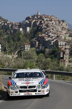 Lancia 037:  Oh, and I want to drive it here, with the Mediterranean sky above and the sea below.  Sip wine in a sidewalk cafe, listening to the metal ticking as it cools.