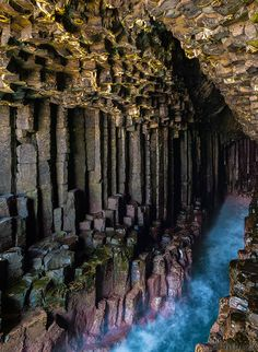 Mysterious Fingal's Cave in Scotland. The cave's structure is indeed unusual: it is made of hexagonally-jointed basalt columns. The cave is the result of a lava flow. Places Around The World, Oh The Places You'll Go, Places To Travel, Places To Visit, Around The Worlds, Beautiful Landscape Photography, Beautiful Landscapes, Fingal's Cave, Sea Cave