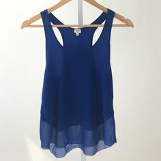 Sill blue Tank Top Elegant sleeveless top. A warm royal blue, it has no stains or signs of wear! Fits closer to a small. Aritzia Tops Tank Tops