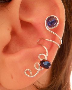 This ear cuff is adorable. It has Swarovski sparkling crystal and one transparent dark blue bead. It is made from aluminium wire. The silver color wil