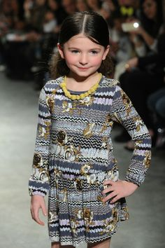 A model walks the runway in IMOGA  by Alivia Simone at Petite Parade Kids Fashion Week on March 8, 2014 in New York City.