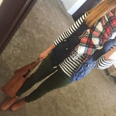 Navy Puffer Vest, striped long sleeve shirt, plaid blanket scarf, olive jeans, cognac booties
