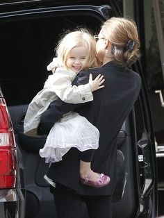 Angelina Jolie and a laughing child!  What a perfect addition to any day.  :)