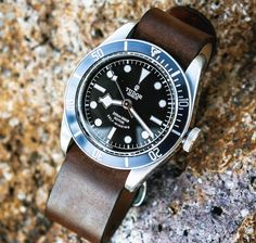 Our Tudor Black Bay on our well worn whiskey Cordovan leather NATO strap. www.bexargoods.com by bexargoods