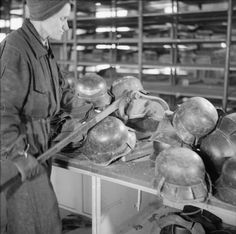 GERMANY UNDER ALLIED OCCUPATION. Salvaged German steel helmets in a Berlin factory being made into saucepans. Here the rims of helmets are cut away.