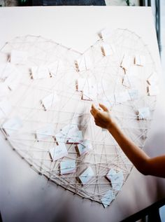DIY Heart Display for Escort Cards | String Art | See more on #SMP:  http://www.stylemepretty.com/2013/12/16/south-of-france-wedding-at-chateau-dalpheran/ Wesley Nulens Photography