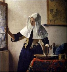 """Young woman with a water jug"" by Vermeer."