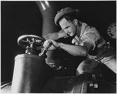 An operator adjusts a gate valve at the Tennessee Valley Authority synthetic amonia plant in the Muscle Shoals, Alabama area 1942