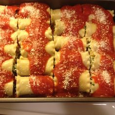 Chicken spinach and cheese lasagna roll ups.