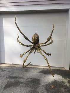 Easy DIY Hanging Spider. Made from aluminum foil and wire armature covered in hot glue. Posable legs