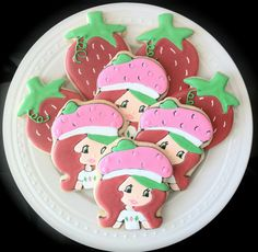 Strawberry Shortcake decorated cookies are great birthday party favors.