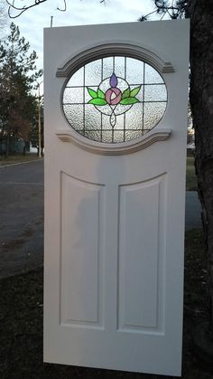 1930's oval  glazed front door  with new stained glass .