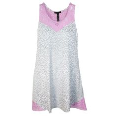 This lace trimmed nightgown is too pretty to keep under the covers. The lace neckline and shoulders add a feminine feel to this silky soft gown. The hem features lace accents on the sides. This nightgown combines style, function and comfort. Whether you are lounging around the house or tucked in bed you will want to be wearing this night gown.