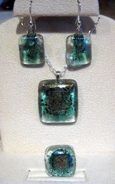 Jewelry made by recycling bits of stain glass metal shavings and bits of glass.  Check out the how-to link    http://www.delphiglass.com/blog/how-to/how-to-make-a-scrap-metal-pendant