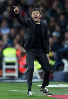 Head coach Luis Enrique Martinez of FC Barcelona gives instructions during the La Liga match between Real Madrid CF and FC Barcelona at Estadio Santiago Bernabeu on November 21, 2015 in Madrid, Spain.