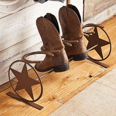 """Western Star Horseshoe Boot Rack - A Black Forest Decor Exclusive - A row of horseshoes holds two pairs of boots on the steel Western Star Horseshoe Boot Rack in a frontier rust finish with circled stars on the ends. Measures 24""""W x 9""""D x 9 1/2""""H. ~"""
