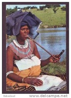 xhosa lady smoking traditional pipe and wearing traditional clothing - 1968 postcard