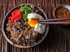 If ramen is like the hamburger of Japan, gyudon—steamed rice topped with beef and onions simmered in sake and soy sauce—is its hot dog: a quick, easy meal that's equally at home at the food court or on your kitchen table.