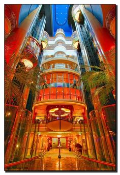 Go for the gold. The elevators of Liberty of the Seas are a stunning display of cruise ship architecture. #RoyalCaribbean