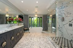 Jeff Lewis - Master bath black and white, herringbone marble floors, free standing tub, shower floor, chandelier