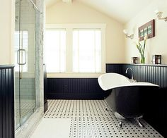 This subtle black and white tile looks classic while making the room appear larger. More bathroom flooring ideas: http://www.bhg.com/bathroom/flooring/bathroom-flooring-ideas/?socsrcbhgpin052513vintage&%20page=1