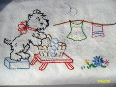 The only embroidery I've done for ages, from a new pattern found at a quilt shop this summer. Embroidered on an Aunt Martha red stripe towel.  Flickr - Photo Sharing!