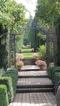 Gate of beautiful garden/Hedges and Gate could make an enchanting entrance to the front yard....with a brick path.