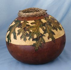 Black Oak leaves circle the gourd.  Had a lot of fun creating this one.