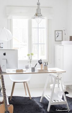 White home office. Switch the chair for a pinned wingback chair and add some more colour