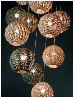 Knitted/crochet light fixture created in Africa. The pattern of the knitted circles is hand woven.