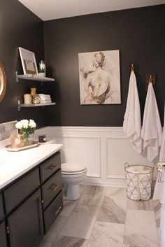 gray vanity, gold hardware
