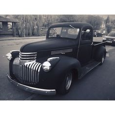 A '41 Chevy pickup parked outside