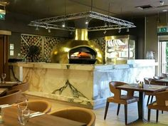 Golden pizza oven. WoodStone oven custom built by owner and finished off in 24k gold leaf. Italian restaurant. Pizzeria. Design.
