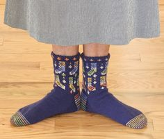 Knitting pattern for hand-knit socks using stranded colorwork knitting. Fun design for those who love to knit and wear handmade socks! #knitwisedesign