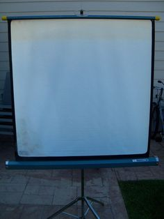 Vintage Projector Screen perfect for viewing the family's old home movies