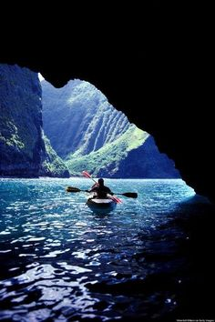 Hawaii. Canoeing the caves along the Na Pali coast of Kauai, the north-western most of Hawaii's major islands.