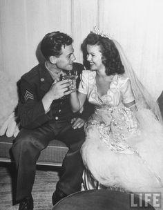 Shirley Temple, 17, clad in a gorgeous satin wedding dress, w. her husband Air Force Sgt. John Agar. 1945