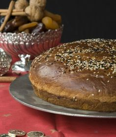 Vasilopita - traditional Greek sweet bread made for the first day of year Greek Sweets, Greek Desserts, Greek Recipes, Fun Desserts, Vasilopita Cake, Vasilopita Recipe, Christmas Sweets, Christmas Cooking, Greek Christmas