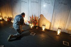 Edward Noon, 22, of the Pennsylvania National Guard, paid tribute to the passengers and crew of Flight 93, while candles remained lit along the Wall of Names