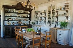 antique cupboard takes the place of built in cabinets along with open shelves.