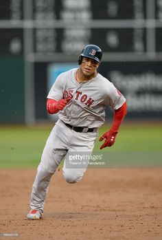 Yoan Moncada #65 of the Boston Red Sox rounds third base to score on an rbi single from Jackie Bradley Jr. #25 against the Oakland Athletics in the top of the third inning at Oakland-Alameda County Coliseum on September 3, 2016 in Oakland, California.