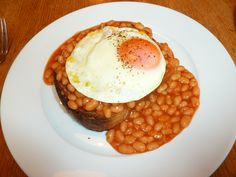 Heinz Baked Beans, toast (I usually have two) and a fried egg on top. Nice late night treat. #putaneggonit Red neck it !