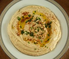 Creamy and delicious, this classic hummus recipe is vegan, healthy and easily customizable to any combination of flavors you can dream up - Feasting Not Fasting